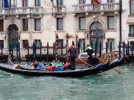 Tourists enjoying a gondola ride