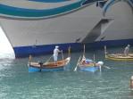 Dgħajsa boat under cruise ship